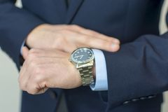 Businessman looking at his watch on his hand Royalty Free Stock Image