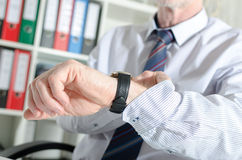 Businessman looking at his watch Royalty Free Stock Photo