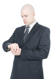 Businessman looking on his watch over white Stock Photos