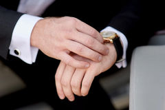 Businessman looking at his watch punctuality Royalty Free Stock Photos