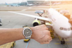 Businessman looking at his wristwatch. Businessman looking at his wristwatch at the airport terminal Royalty Free Stock Image