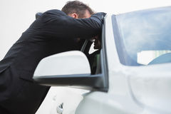 Businessman looking inside the car Stock Photo