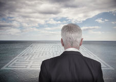 Businessman looking at landscape and maze Stock Image