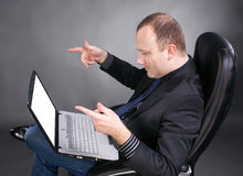 Businessman looking at laptop Stock Images
