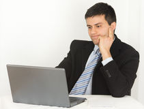 Businessman looking at laptop Royalty Free Stock Photography
