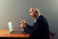 Businessman looking at laptop Royalty Free Stock Photo