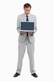 Businessman looking at the laptop he is presenting Stock Photos