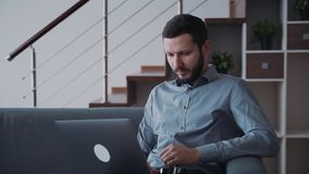 Businessman is looking on laptop screen and analyzing all new information from finance network resource. Attractive technology of shopping online and corporate stock footage