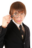 Businessman looking through a magnifying glass Stock Photography