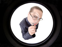 Businessman looking through magnifying glass Royalty Free Stock Photography