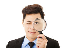 Businessman looking through magnifying glass Royalty Free Stock Image