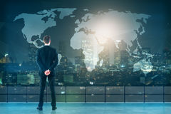 Businessman looking at map Stock Images