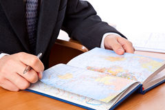 Businessman is looking on map in organizer Stock Image