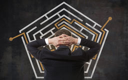 Businessman looking at a maze Stock Photography