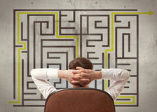 Businessman looking at a maze Stock Images