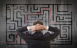 Businessman looking at a maze Royalty Free Stock Images