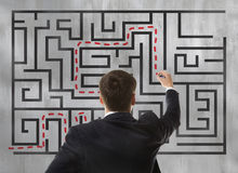 Businessman looking at a maze Stock Image