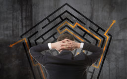 Businessman looking at a maze Royalty Free Stock Photos