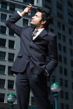 Businessman looking at mobile phone Royalty Free Stock Images