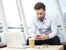 Businessman looking at mobile phone Royalty Free Stock Photo