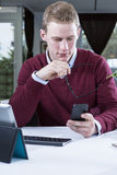 Businessman looking the mobile phone Royalty Free Stock Photography