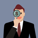 Businessman looking for money future through a magnifying glass Royalty Free Stock Image