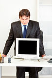 Businessman looking in monitors blank screen Stock Photography