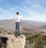 Businessman looking on mountain Royalty Free Stock Photos