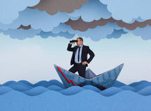 Businessman looking for new opportunities. And sailing in stormy papers sea. Paper waves, clouds and boat Royalty Free Stock Photos