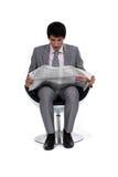 Businessman looking at a newspaper Stock Photos