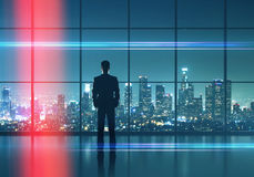Businessman  looking in night city Stock Images