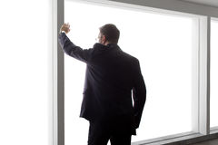 Businessman Looking Out a Big Window Stock Photography