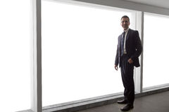 Businessman Looking Out a Big Window Stock Images