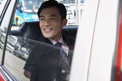Businessman Looking Out Of Car Window Royalty Free Stock Photo
