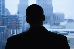 Businessman Looking Out of Window Stock Images