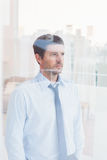 Businessman looking out the window Royalty Free Stock Images