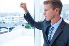 Businessman looking out the window Royalty Free Stock Photography