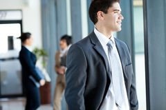 Businessman looking outside Stock Photos