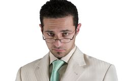 Businessman looking over his glasses. Isolated businessman looking over his glasses Royalty Free Stock Photography