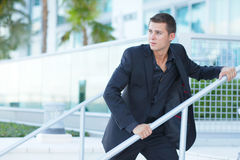 Businessman looking over his shoulder Royalty Free Stock Images