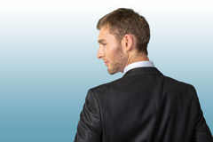 Businessman looking over his shoulder Royalty Free Stock Photo
