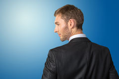 Businessman looking over his shoulder Royalty Free Stock Image