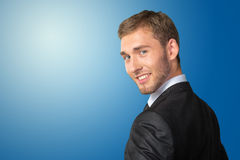 Businessman looking over his shoulder Stock Image