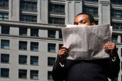 Businessman looking over newspaper Royalty Free Stock Photography