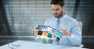 Businessman looking at panels spinning on desk Royalty Free Stock Photography