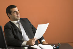 Businessman Looking at Paperwork - Horizontal Royalty Free Stock Photo