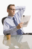Businessman Looking at Paperwork - Isolated Royalty Free Stock Photography