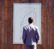 Businessman looking on parking booth plan Royalty Free Stock Photography