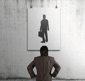 Businessman looking at people icon Stock Photography