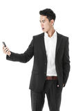 Businessman looking perplexed with a phone Royalty Free Stock Photography